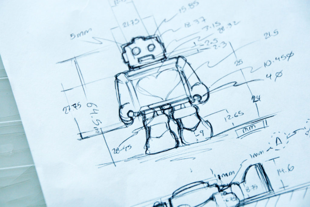 Robot toy industrial design concept sketch with measurements and orthographic views