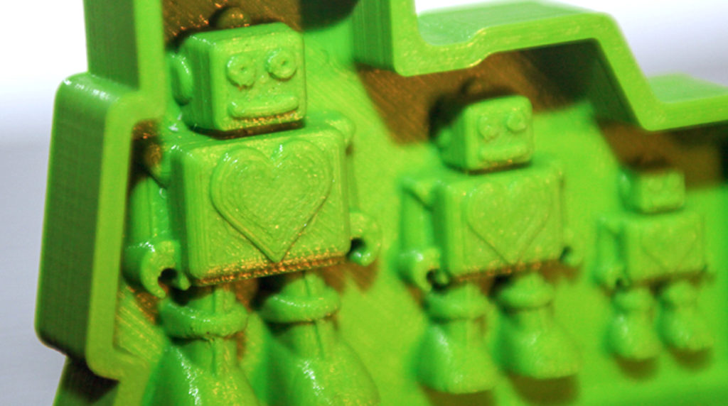 Close up of Robot toy 3D printed product prototype molds printed in green PLA