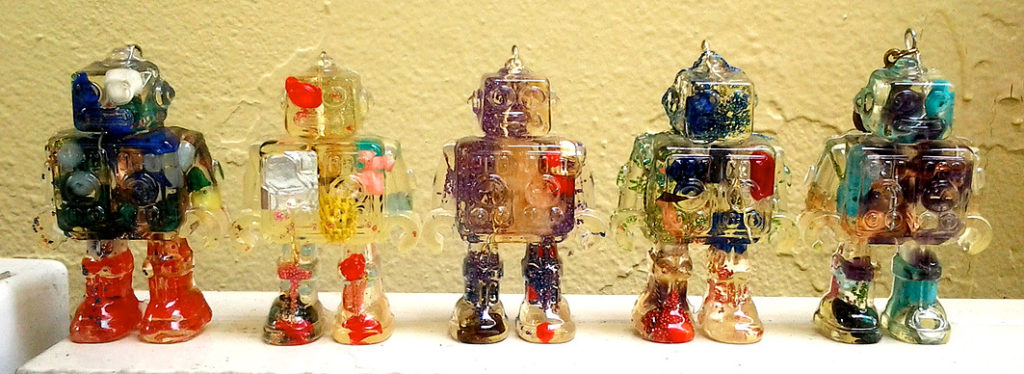 Robot toys product design made with resin and gemstones from molds on a table
